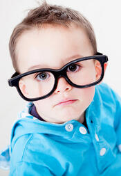 Little boy wearing big glasses - isolated over a white background