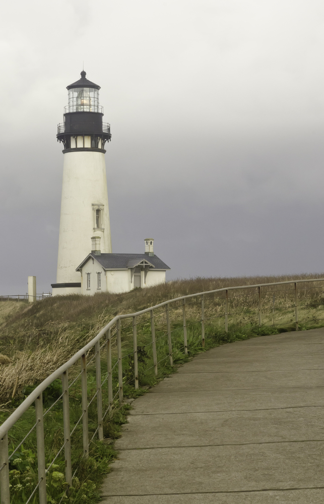 Yaquina Head Lighthouse, a popular tourist attraction built in 1871 in Newport, Oregon, on a stormy morning in September along the Pacific coast